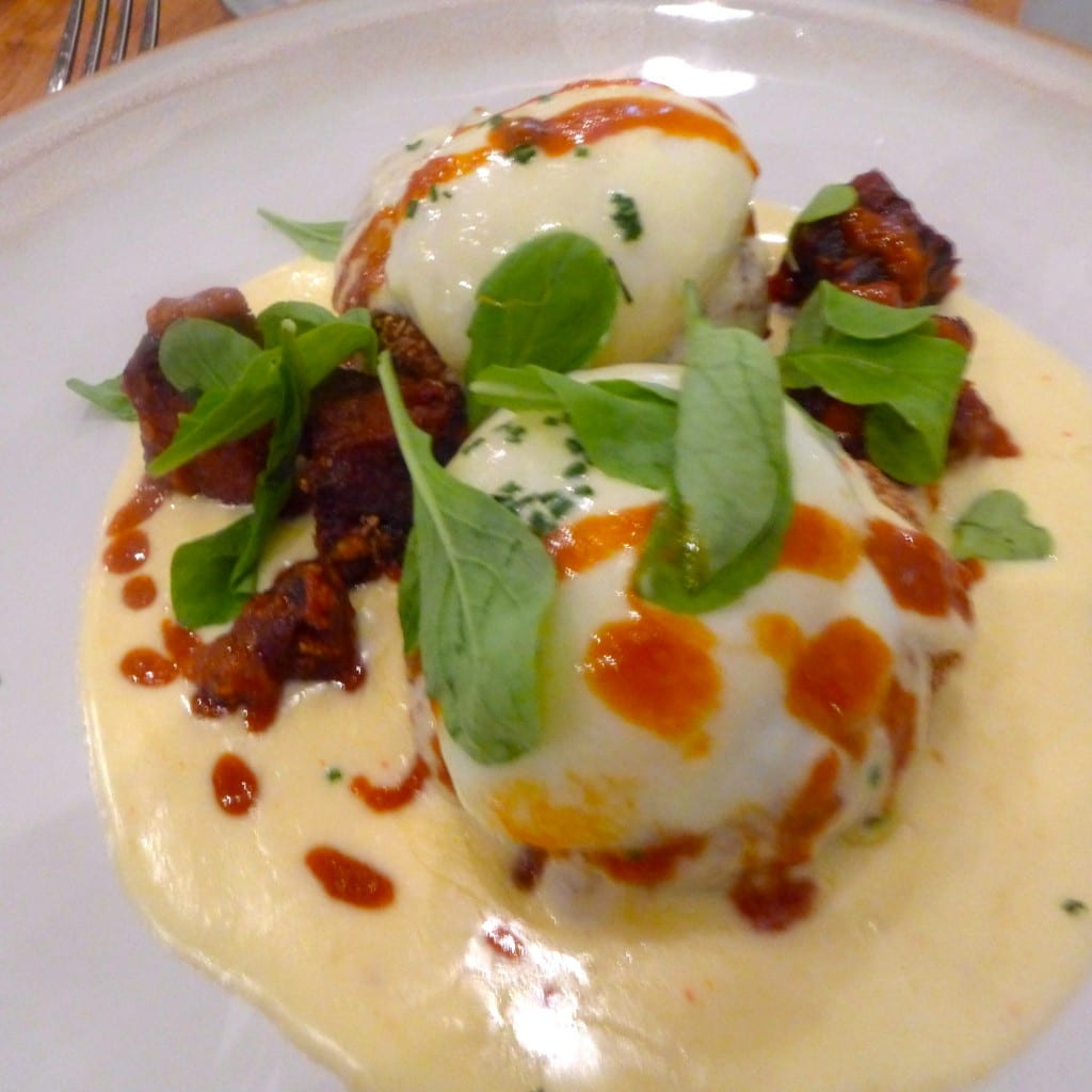 Potato Croquettes with Poached Eggs, Crispy Pork and Hollandaise Photo: Maralyn D. Hill